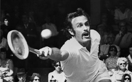 Australian tennis player John Newcombe returns a b...LONDON, UNITED KINGDOM:  Australian tennis player John Newcombe returns a ball against G. Battrick, 27 June 1971, during the Wimbledon championships. After defeating the opponent, Newcombe, who had previously won twice the men's single title at Wimbledon, went on to reach a third victory in the competition. (Photo credit should read AFP/AFP/Getty Images)