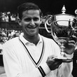 2nd July 1965:  Australian tennis player Roy Emerson holding the Wimbledon trophy after winning the mens' singles at Wimbledon. He beat compatriot Fred Stolle, 6-2, 6-4, 6-4.  (Photo by Roger Jackson/Central Press/Getty Images)