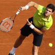 Local Input~ Canadian Milos Raonic hits a return to Spanish Albert Montanes during the Monte-Carlo ATP Masters Series Tournament tennis match, on April 16, 2012 in Monaco. AFP PHOTO/ VALERY HACHE (Photo credit should read VALERY HACHE/AFP/Getty Images)