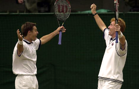 Mark Woodforde and Todd Woodbridge of Australia celebrate beating Paul Haarhuis of Holland and Sandon Stolle of Australia during the final of the mens doubles at Wimbledon, 2000.